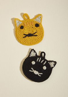 <p>Once this set of two crocheted cotton cats arrives in your kitchen, chores will be boring no more! Handmade with little loops to help toward your organization efforts, these orange-and-black faced friends will bring functional bliss into your flat.</p>
