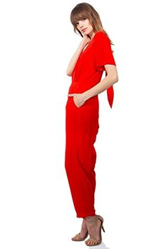 Stand out in this red short sleeve #jumpsuit. Features an adorable bow tie detail in the back. Pair it with pointed heels and a choker necklace to complete the l...
