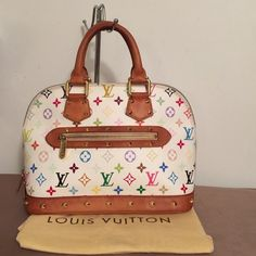 HOST PICK Authentic Louis Vuitton Alma Authentic  Louis Vuitton Multicolor Alma   Red soft interior w/ 2 pockets  Date code (photo #4) Exterior canvas good condition  Exterior white leather has no tears or discoloration Slight discoloration on white interior (photo 4) by zipper Vahetta has wear, has patina to honey brown Vahetta corners has wear, no tears photo 3 Handles show wear from use Brass hardware, studs great condition Zipper works great  Interior red in great condition No tears bag…