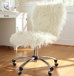 DIY it - throw a fuzzy white blanket over your chair. White fuzzy/fluffy rolling chair