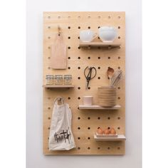 The new Peg it all pegboard includes shelves and pegs which all slot easily into the main board giving an endless range of storage options.  -Comes with 1 small shelf, 1 large shelf and 6 straight pegs -By Swiss born designer Nikki Kreis at Kreisdesign -Wall mounting battens and installation instructions are included