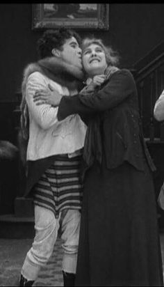 Charlie Chaplin and Edna Purviance in A Woman