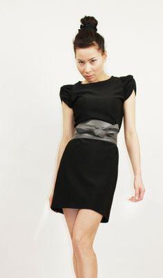 Edgy urban twisted sleeve dress