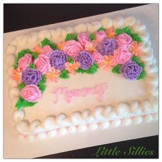 Mom birthday. White 1/4 sheet cake with buttercream pink roses, coral wild roses and purple carnations.