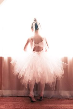 I'm thinking kinda like this. Simple leotard and a tutu that doesn't completely cover their legs, but still is long enough.
