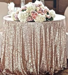 Champagne coloured sequin tablecloth - see more ideas at http://themerrybride.org/2014/09/13/champagne-and-blush-wedding/