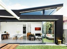 A wraparound clerestory window was designed to capture northern light. The rear elevation is clad in [James Hardie Scyon Axon cement-composite panels House Cladding, Facade House, House Roof, Roof Design, House Design, Weatherboard House, 21st Century Homes, Clerestory Windows, Australian Homes
