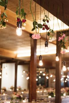 Lighting up the wedding reception with Edison bulbs and gorgeous hanging roses! // Photography: Jacqueline Dalimore