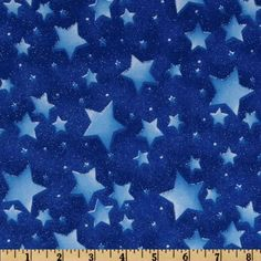 Out Of This World Stars Blue  Designed for Fabric Traditions, this cotton print fabric is perfect for quilting, apparel and home décor accents. This fabric features a metallic glitter finish with colors of shades of blue.