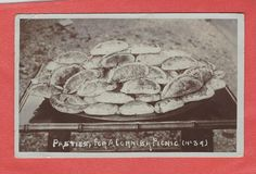 'PASTIES FOR A CORNISH PICNIC': 'A post-marked Lewannick 26 September 1910 Edwardian photographic postcard published by S Dalby Smith, St Blazey, Cornwall showing a large amount of Cornish pasties on a large plate on a table.'     ✫ღ⊰n