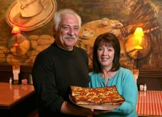 Owners Jack Guerra and Marie Guerra Easterby in 2009 with one of their Detroit-style pizzas at their restaurant, Cloverleaf in Eastpointe.