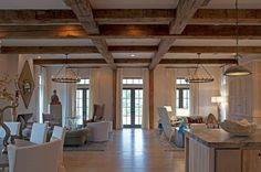 Pair the wood ceiling beams with rustic or antique chandeliers