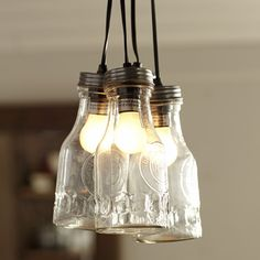 3 Light Jar Pendant from Wayfair Canada. Vintage oil bottles inspired this four-light, hard-wired pendant light with Edison-style filament bulbs. Perfect for any industrial style living room.