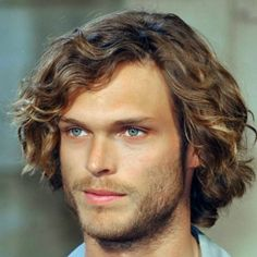 brown mid length curly hair for men