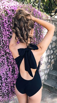 black one piece bathing suit with a bow