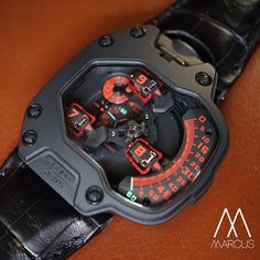 Urwerk Black and Red UR-110. Black titanium case with a platinum bezel. This version have the best color combination in all UR110.