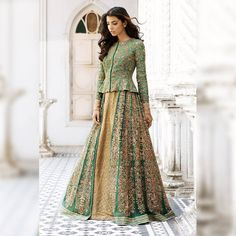 A finely hand embroidered jade peplum jacket with a textured gold lehenga. Stunning green color lehenga and peplum jacket with floral design hand embroidery thread work. Stunning craftsmanship by Shyamal Bhumika. Stylish Blouse Design, Fancy Blouse Designs, Choli Designs, Sari Blouse Designs, Lehenga Designs, Gold Lehenga, Lehenga Choli, Anarkali, Lehenga With Long Choli