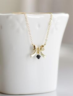 Chic Bow Necklace . gold and black jewelry by CocoroJewelry on Etsy