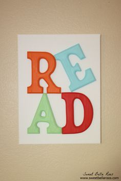 Sweet Bella Roos blogger: DIY solid wood letters, painted and glued onto canvas.
