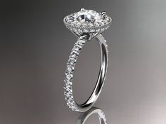 This is gorgeous floral ring. It has 24 VS-SI/G-H color diamonds total weight of 0.40ct. 43 stones white sapphire pave set around the center...