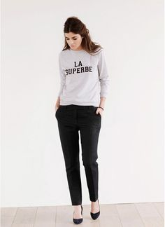 Casual chic: black pants, heels and a sporty sweater