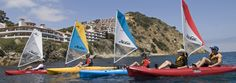 Take your pick:  pedal power, paddle power, or wind power, all in one boat!