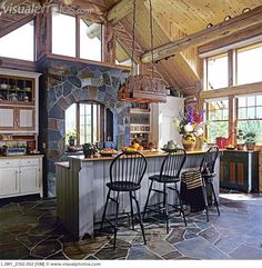 KITCHEN: log home with cathedral ceiling, stone floors and range hood, furniture style cabinets built by David Smith, wood countertops,