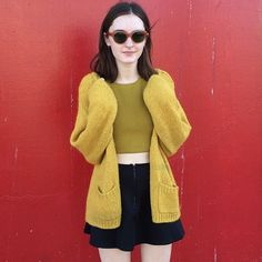 """Mustard knits and sleek minis: Leah in the Mohair Loose Cardigan, V Strap Tank, Brigitte Mini and vintage eyewear. Queer Fashion, Fast Fashion, Fashion Outfits, Tennis Skirts, Monochrome Outfit, Knitwear Fashion, Aesthetic Fashion, American Apparel, Vintage Outfits"