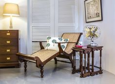 British colonial teakwood easy chair and nest of tables.