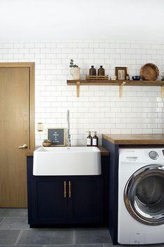 A white farmhouse sink in a modern navy laundry room A whi. A white farmhouse sink in a modern navy laundry room A white farmhouse sink i Navy Cabinets, Laundry Room Cabinets, Laundry Room Organization, Laundry In Bathroom, Laundry Room Utility Sink, Laundry Tubs, Laundry Decor, Basement Laundry, White Farmhouse Sink