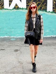 Toughen up a mini skirt with edgy pieces: high-tops, studded bag, and moto jacket