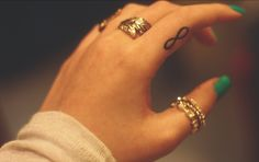 infinity symbol - left ring finger - get when engaged - maybe match with husband