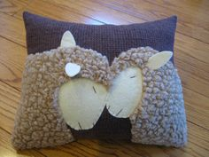 This pillow features two very affectionate sheep. This one, also based on a photograph of real sheep inspired me to make this touching pillow. For the sheep lover in you or for someone you know, it would be a unique and wonderful pillow to add to your home. Hand stitched and done on brown wool, it measures 9 x 11. It is stuffed with polyester fiberfill and comes from a pet and smoke free home.