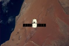 Dragon capsule over Namibia, photo by André Kuipers