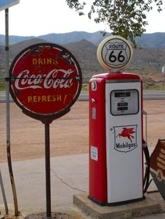 Coca-Cola lollipop sign and Mobil gas pump in Hackberry, AZ on Route 66 Vintage Coca Cola, Old Gas Pumps, Vintage Gas Pumps, Drive In, Route 66 Road Trip, Route 66 Sign, Pompe A Essence, Always Coca Cola, Old Gas Stations