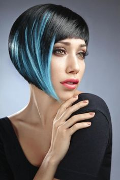 What an amazing coloring job done on the part of the colorist on this hairstyle, the fusion of blues used on the dark black hair is breathtaking and looks amazing! Not to mention the incredible job done on the cut as well framing the coloring to perfection with this edgy futuristic bob cut.