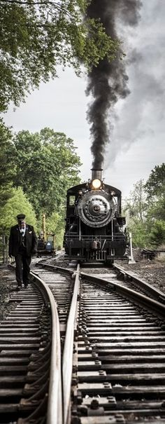 Inspecting the switch by walking in front of the locomotive.