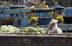 If you do visit Mekong Delta floating markets the best time to see them is after spending the night on a traditional wooden boat. Markets as busiest at dawn so you have to rise early! Laos, Vietnam, Thailand, Mekong Delta, Asian Market, Float Your Boat, China, Wooden Boats, Places Ive Been