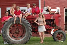 Love the idea of incorporating the farm machinery into photos, I mean after all, isn't the tractor supposed to be worth as much as the house? ;)