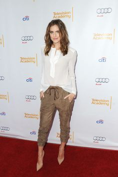 Star of Girls on HBO, Allison Williams, dresses up her Brunello Cucinelli trousers with a silk top by the designer, and Christian Louboutin pumps // #Style #Spring #Fashion