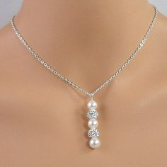 White pearl, crystal pave ball pendant wedding necklace on a sterling silver chain.  A lovely necklace for a bride.  BUY NOW http://jewelrybytali.com/products/white-pearl-pave-crystal-ball-sterling-silver-bridal-necklace