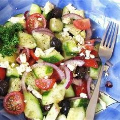Good for You Greek Salad: tomatoes, cucumbers, red onion, olive oil, lemon juice, oregano, feta cheese, olives,