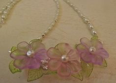 'Acrylic and Pearl Flowers Necklace' is going up for auction at 10am Mon, Apr 8 with a starting bid of $8.