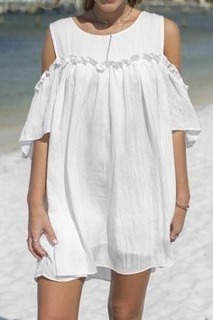 Cream dress features off the shoulder sleeves, ruffle details, and lining Material is Polyester and Rayon Model Darien is 5'5 wearing a small Bust Length Small