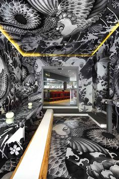 Imagine dining surrounded by gangsta tattoo art. This is now possible in Aix-en-Provence, where patrons of a Japanese restaurant are surrounded by vast monochromatic motifs inspired by the Japanese Yakuza. The environment is a stylish feast for the senses. We may just forget to focus on our plat ...