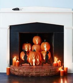 pumpkin carving design ideas. pumpkins with flames as fireplace decor. great idea for a spooky halloween party. more fun than candles in the fireplace. by kristyhaupt