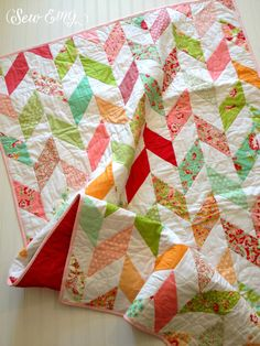 Bright sunny days are ahead and how perfect would this spring quilt look lovingly draped across your mama's favorite rocking chair? Imagine it hanging beautifully against a white bassinet or wrapped around a sweet baby girl! Herringbone Quilt by SewEMG www.sewemg.com