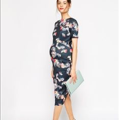 NWT Asos maternity floral midi dress. NWT Asos maternity blue with floral midi dress, stretch scuba material (polyester, elastane blend). Structured and form fitting. Small slit in back hem for sexiness. Size 2. ASOS Dresses Midi