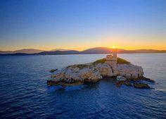 Sunrise behind the lighthouse of Kaparelli, Corfu island, Ionian Sea, Greece