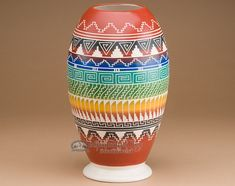 This is a high quality piece of authentic Native American, Navajo pottery. This unique piece of Navajo pottery is artfully hand etched and painted to decorate the rustic character of the southwest.The
